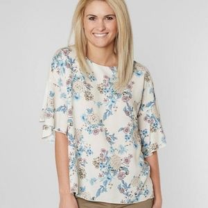 BKW Boutique Cream and Floral short sleeve blouse